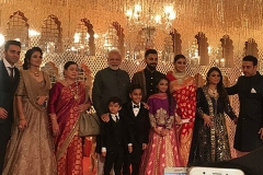 Posing with family and Narendra Modi