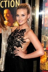 Perrie Edwards with engagement ring on at one direction movie premiere