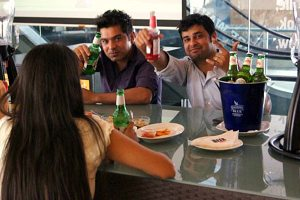 Friends drinking Indian Beer