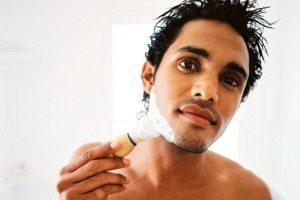 Asian man shaving
