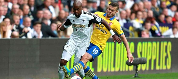 Premier League Swansea City vs Arsenal Jack Wilshere with Dwight Tiendalli