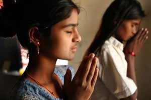 child prostitues praying