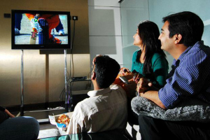 Indian Family Watching TV