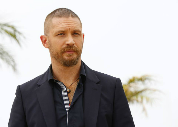 British heartthrob Tom Hardy opted for a stylish Alexander McQueen suit.