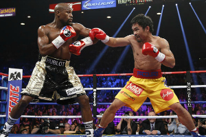 Floyd Mayweather defeats Manny Pacquiao in Las Vegas Fight of the Century