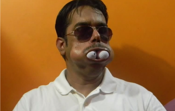 When Dinesh Upadhyaya is not teaching science to his Mumbai pupils, he bides his time breaking world records by stuffing objects into his mouth.