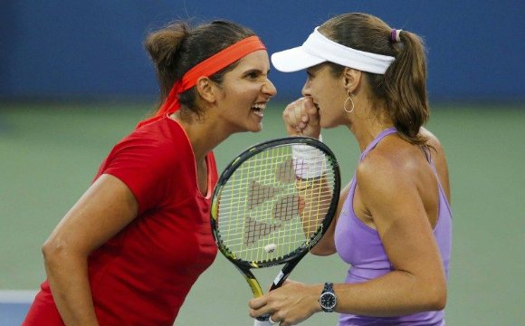 Sania Mirza and Martina Hingis have won back-to-back Grand Slam titles after being crowned US Open women's doubles champion