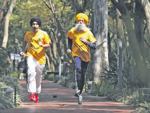 Fauja Singh runs in Ford car advert