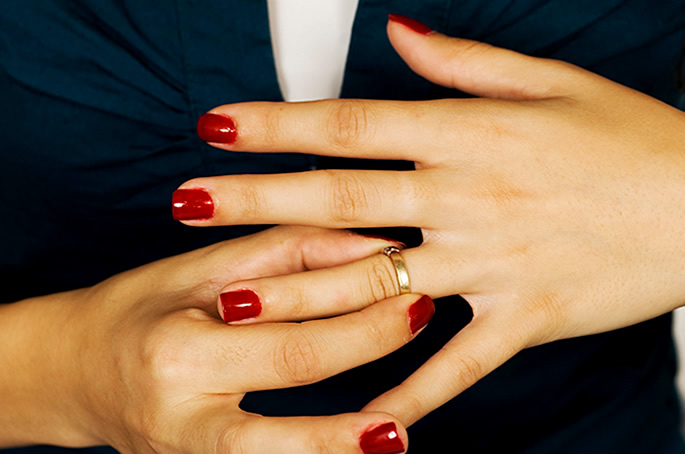 Divorced woman taking off ring