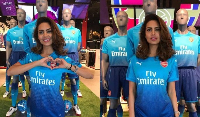 Esha Gupta models Arsenal's new away kit in the club shop