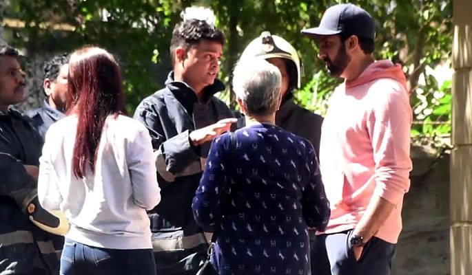 Aishwarya and Abhishek speaking with firefighters