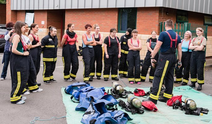 Group of women listening to firefighter