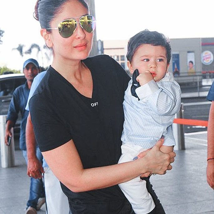 Kareena holding Taimur with sunglasses in his hand