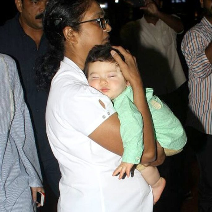 Taimur sleeping in his nanny's arms