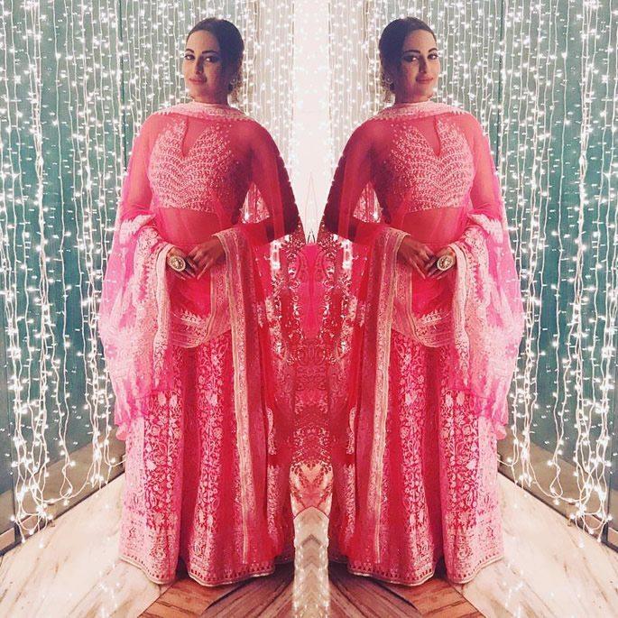 Sonakshi wearing pink and gold lehenga