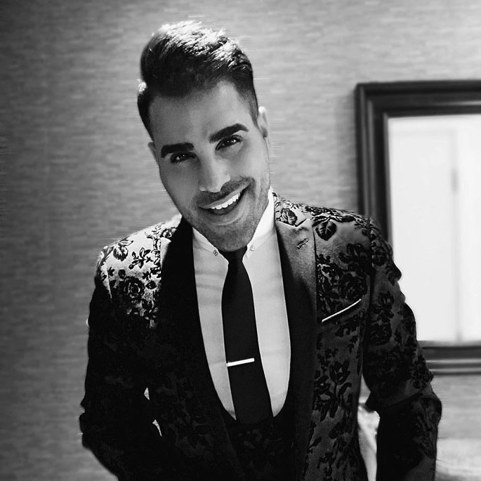 Ranj Singh smiling and wearing a suit