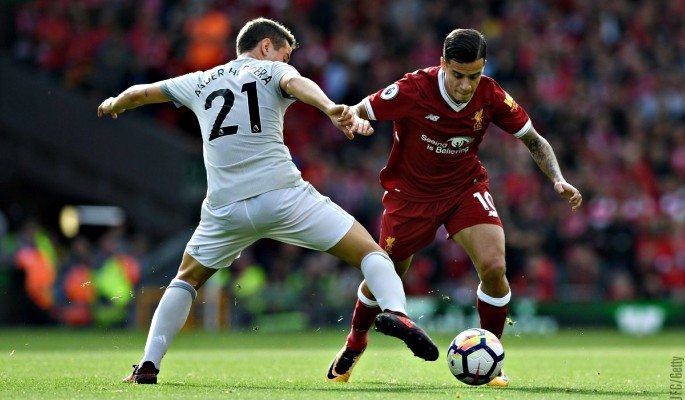 Manchester United's Ander Herrera tries to get the ball from Liverpool's Philippe Coutinho