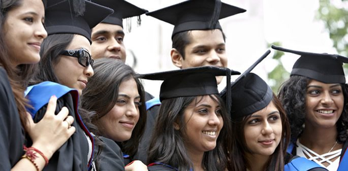 Indian students standing together in graduate uniforms