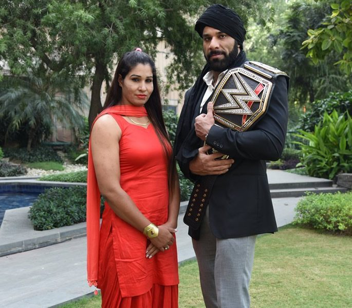 Kavita and Jinder standing together