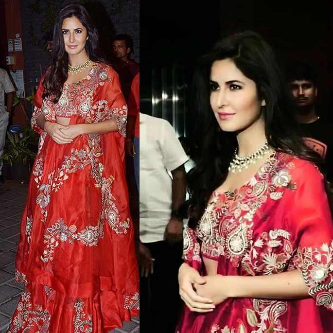 Katrina wears a red, patterned lehenga.
