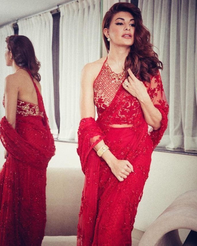 Jacqueline wearing a red saree
