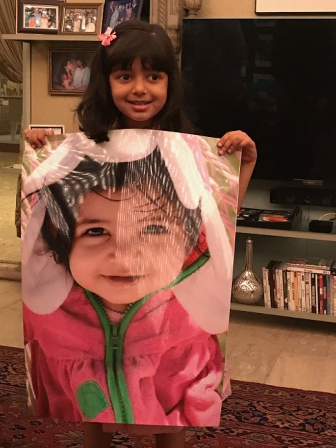 Aaradhya with a image of her younger self