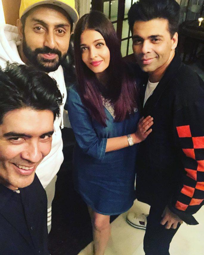 Bollywood stars posing at Manish's party