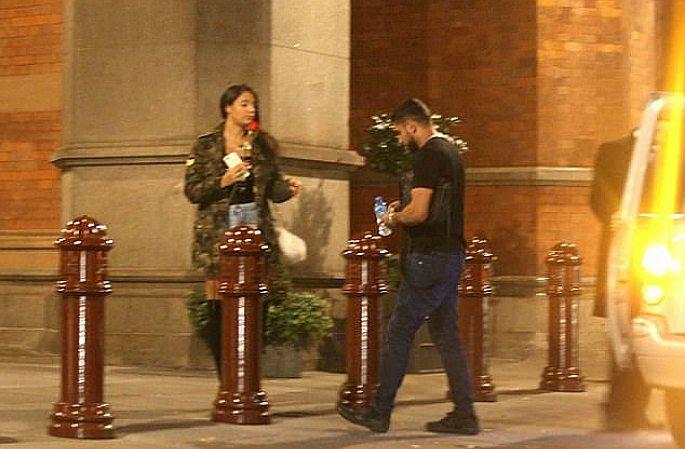 Amir with woman outside shisha bar