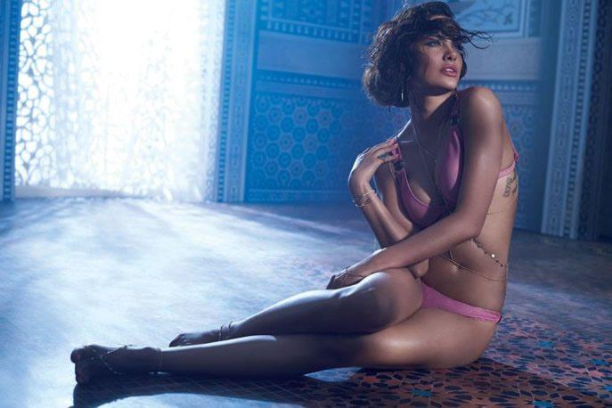 Esha posing in a pink bikini