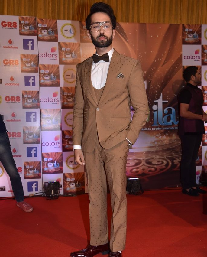 Nakuul Mehta in a light brown suit