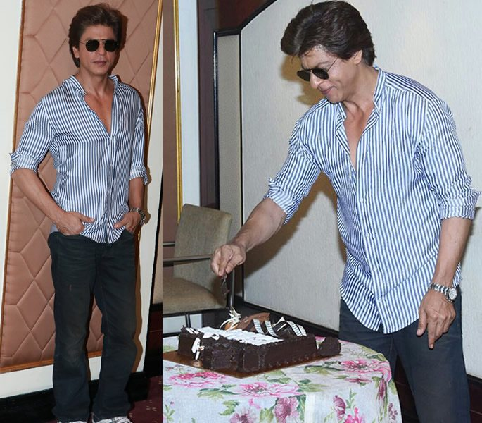 SRK posing and cutting a birthday cake