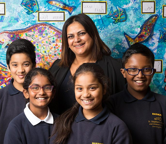 Neena Lall with pupils