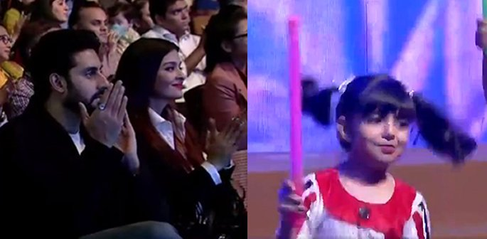 Aishwarya and Abhishek clapping while Aaradhya performs