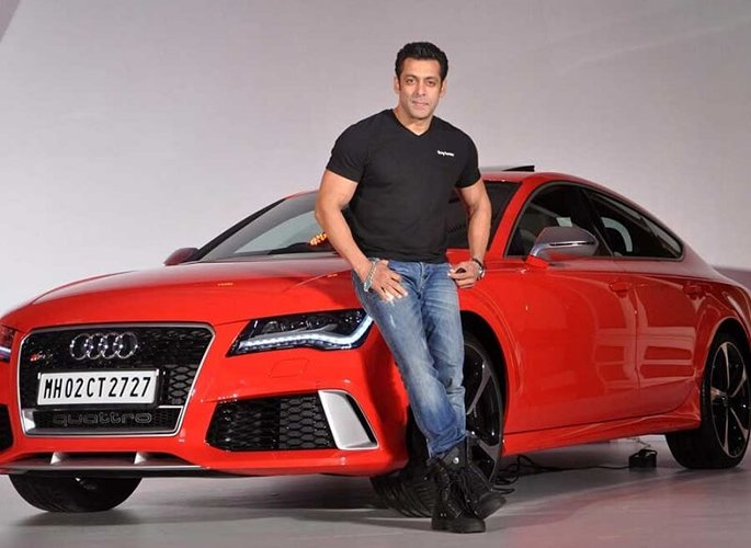 Salman Khan leaning against car
