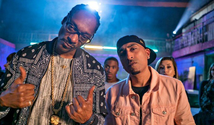 Dr Zeus alongside Snoop Dogg in 'Woofer'