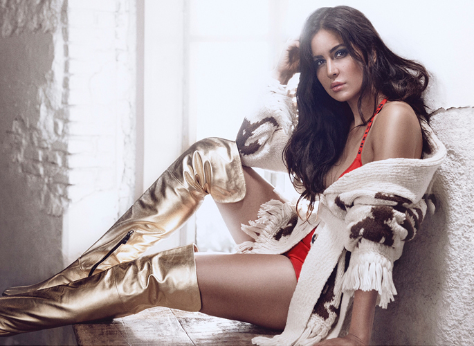 Katrina wearing gold boots and orange bodysuit