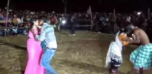 Couples kiss in front of crowds
