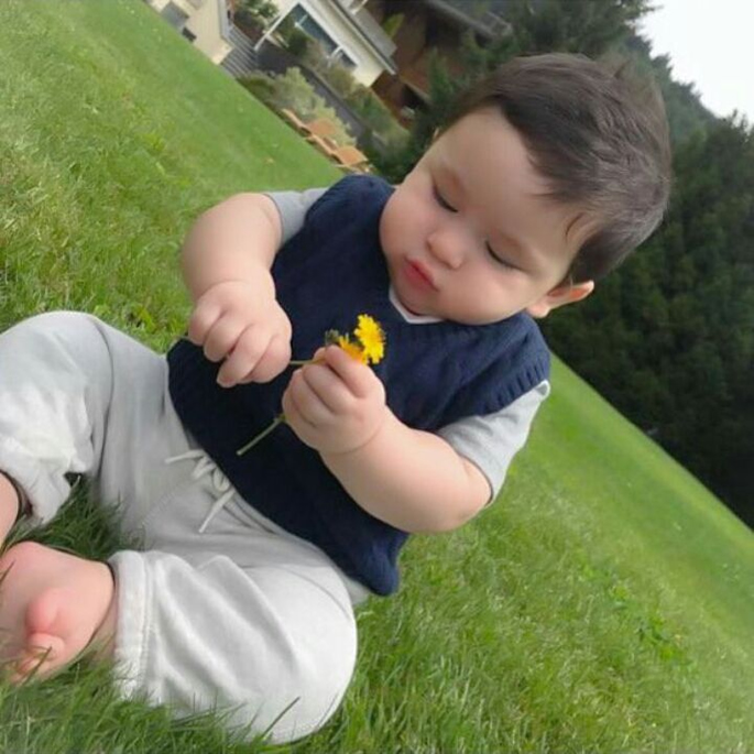 Taimur playing with a flower