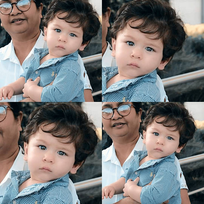 Taimur held by his nanny