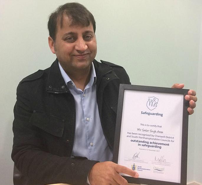 Satbir with certificate