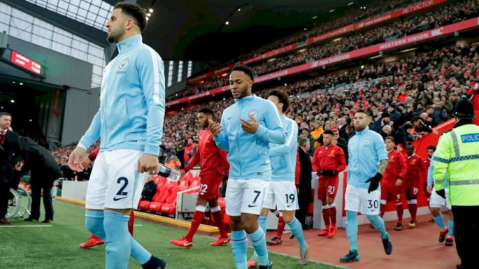 Liverpool and Manchester City teams coming out at Anfield