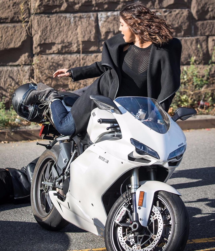 Priyanka on a white motorbike