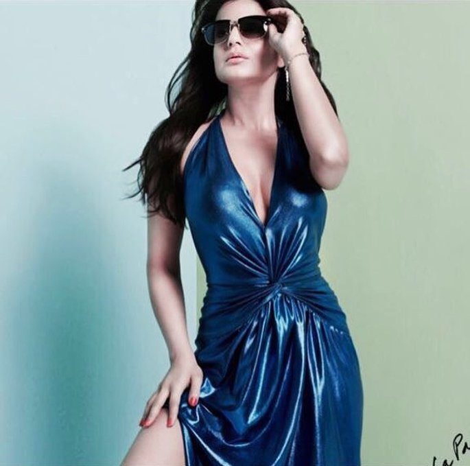 Ameesha wearing sunglasses and a blue dress