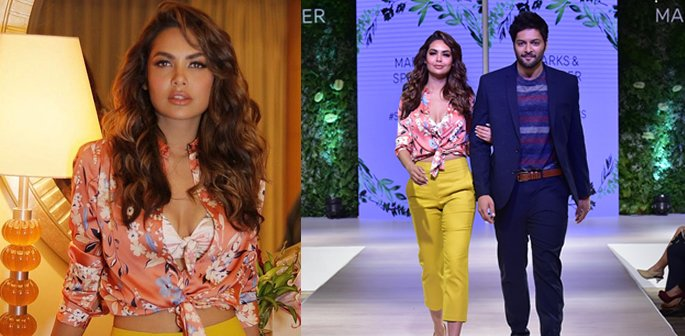 Esha and Ali wearing pieces from the collection