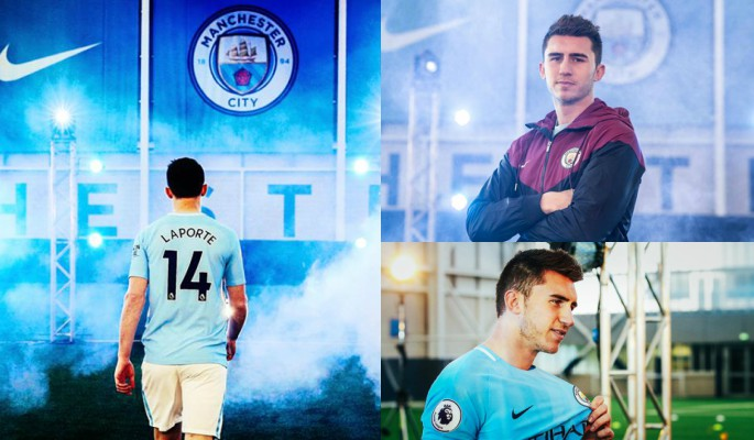 Aymeric Laporte posing in a Manchester City shirt