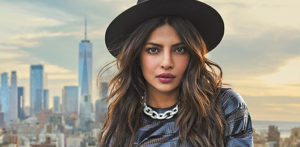 Priyanka Chopra wearing a hat with New York skyline behind her