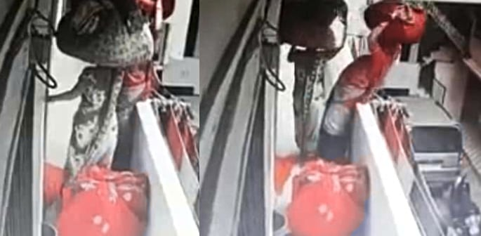 Indian Clothes Worker Falls over Balcony after losing her Balance