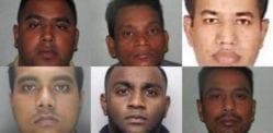 پولیس کی نقالی اور 242,000،XNUMX ڈالر چوری کرنے پر آٹھ افراد کو جیل بھیج دیا گیا