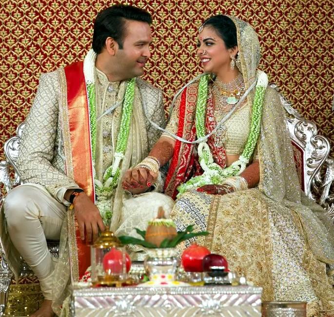 Best Dressed Celebrities at Isha Ambani & Anand Piramal Wedding - happy couple