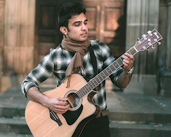 Introducing Shoaib Rana: A Fresh Face in Music - shoaib rana guitar